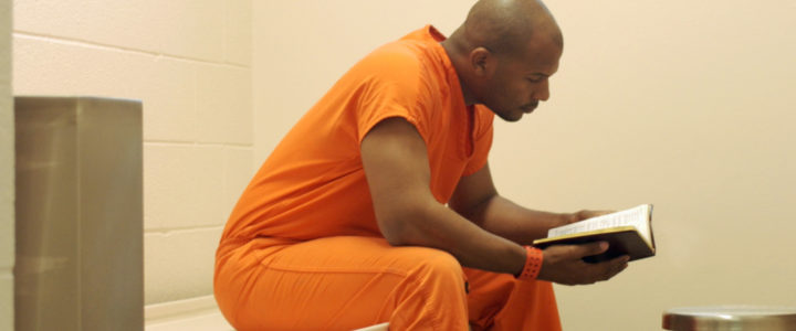 Studying Bible In Prison
